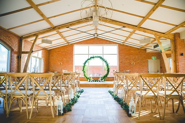 The Ceremony Room with central table and aisle lanterns