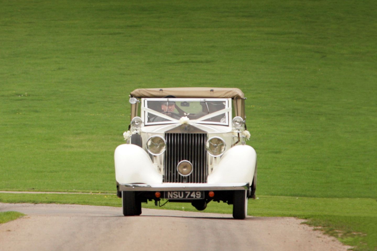 Vintage Rolls Royce coming down the drive